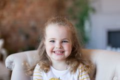 Portrait of beautiful pretty girl, smiling. Indoor photo. Close-up royalty free stock images