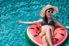 Portrait Beautiful Pretty woman girl plays watermelon ring buoy. In swimming pool blue water royalty free stock photos