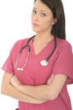 Portrait Of A Beautiful professional Serious Concerned Young Female Doctor with Stethoscope Royalty Free Stock Photo