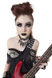 Portrait beautiful punk woman staring while holding guitar over white background Stock Image