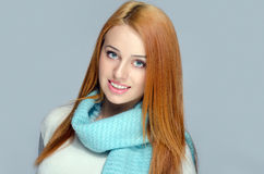 Portrait of a beautiful red hair woman wearing a blue scarf smiling. Stock Image