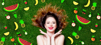 Portrait of beautiful red-haired girl with drawn fruits Royalty Free Stock Image