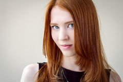 Portrait of a beautiful , red-haired girl. Emotional portrait of red-haired girl Royalty Free Stock Photo