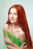 Portrait of beautiful red-haired girl with flower painted on his face Royalty Free Stock Images