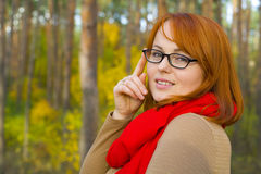 Portrait of beautiful red-haired girl in glasses Stock Photography