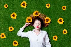 Portrait of beautiful red-haired girl with sunflowers Stock Image