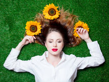 Portrait of beautiful red-haired girl with sunflowers Royalty Free Stock Photo