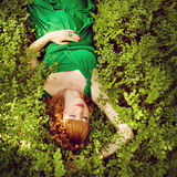 Portrait of a beautiful red-haired pregnant girl in a green dres Royalty Free Stock Photography