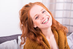 Portrait beautiful red-haired woman in orange cardigan Royalty Free Stock Photos