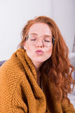 Portrait beautiful red-haired woman in orange cardigan with  kis Royalty Free Stock Photography
