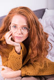 Portrait of beautiful, red-haired woman with orange sweater.  Stock Photography