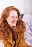 Portrait of beautiful, red-haired woman with orange sweater Stock Photo
