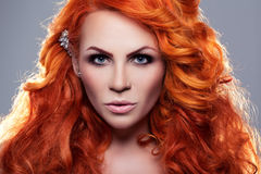 Portrait of beautiful red-haired woman Royalty Free Stock Photography