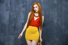 Portrait of the beautiful red haired woman Stock Photo