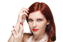Portrait of beautiful red- haired woman. Royalty Free Stock Images