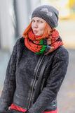 Portrait of beautiful red-haired young woman in hat and scarf Royalty Free Stock Photos