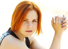 Portrait of a beautiful red-haired young woman Stock Photography