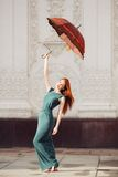 Portrait of beautiful red-haired young woman. With umbrella Stock Photo
