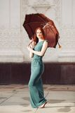 Portrait of beautiful red-haired young woman. With umbrella Royalty Free Stock Photo