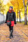 Portrait of beautiful red-haired young woman walking in autumn p Stock Images