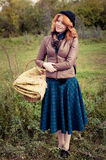 Portrait of a beautiful redhair girl in the autumn park. Caucasian race Royalty Free Stock Photos
