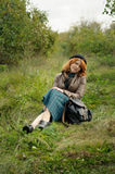 Portrait of a beautiful redhair girl in the autumn park. Caucasian race Royalty Free Stock Image