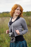 Portrait of a beautiful redhair girl in the autumn park. Stock Photos