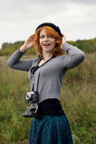 Portrait of a beautiful redhair girl in the autumn park. Royalty Free Stock Photography