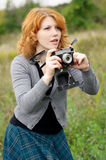 Portrait of a beautiful redhair girl in the autumn park. Royalty Free Stock Image
