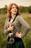 Portrait of a beautiful redhair girl in the autumn park. Royalty Free Stock Photo