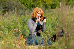 Portrait of a beautiful redhair girl in the autumn park. Royalty Free Stock Photos