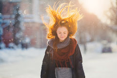 Portrait beautiful redhair girl in frosty winter weather. Royalty Free Stock Photography