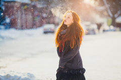 Portrait beautiful redhair girl in frosty winter weather. Stock Image