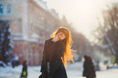 Portrait beautiful redhair girl in frosty winter weather. Stock Photo