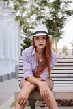 Portrait of beautiful redhair woman in a hat, summer outdoors royalty free stock photos