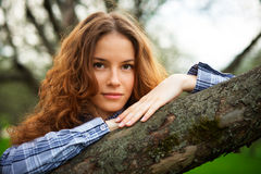 Portrait of a beautiful redhead girl. In the spring garden Royalty Free Stock Image