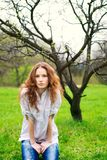 Portrait of a beautiful redhead girl. In spring garden Royalty Free Stock Photography