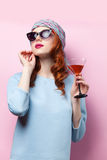 Portrait of beautiful redhead girl with drink Royalty Free Stock Photo