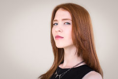 Portrait of a beautiful , redhead girl. Emotional portrait of a girl . Arrogance Royalty Free Stock Photo
