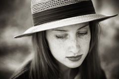 Portrait of a beautiful redhead girl in hat Royalty Free Stock Image