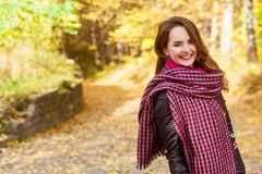 Portrait of beautiful redhead girl walking the park. Toothy smil. E. Warm sunny autumn weather. Outdoors shot Stock Images