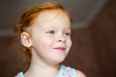 Portrait of a beautiful redhead happy laughing little girl royalty free stock photos