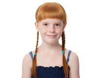 Portrait of a beautiful redhead joyful little girl in a blue dress Stock Images
