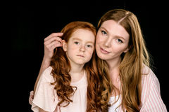 Portrait of beautiful redhead mother and daughter posing together Royalty Free Stock Images
