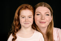 Portrait of beautiful redhead mother and daughter posing together Royalty Free Stock Photography