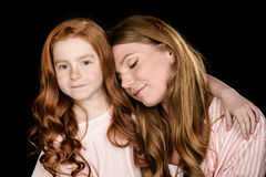 Portrait of beautiful redhead mother and daughter posing together Stock Images