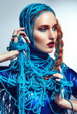 Portrait of beautiful redhead woman with blue threads Royalty Free Stock Images