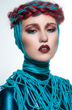 Portrait of beautiful redhead woman with blue threads Royalty Free Stock Image