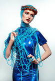 Portrait of beautiful redhead woman with blue threads Stock Photos