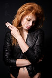 Portrait of beautiful redhead woman with a cigaret Stock Images
